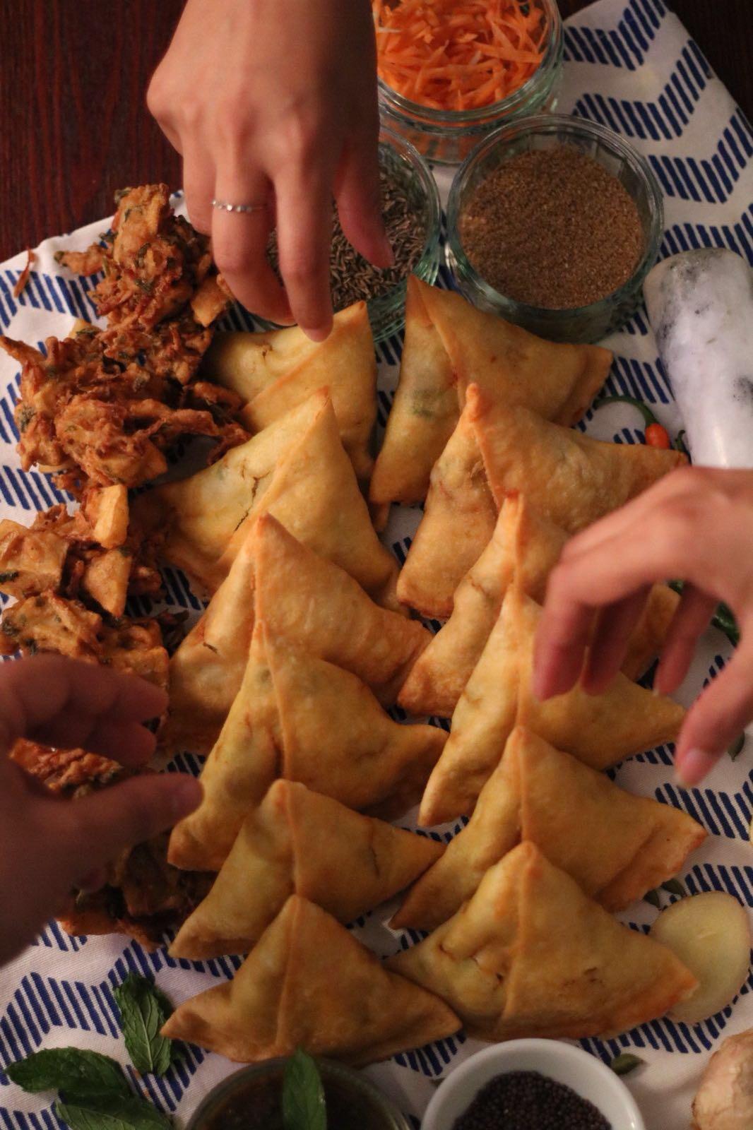 sharing samosas and bhajis
